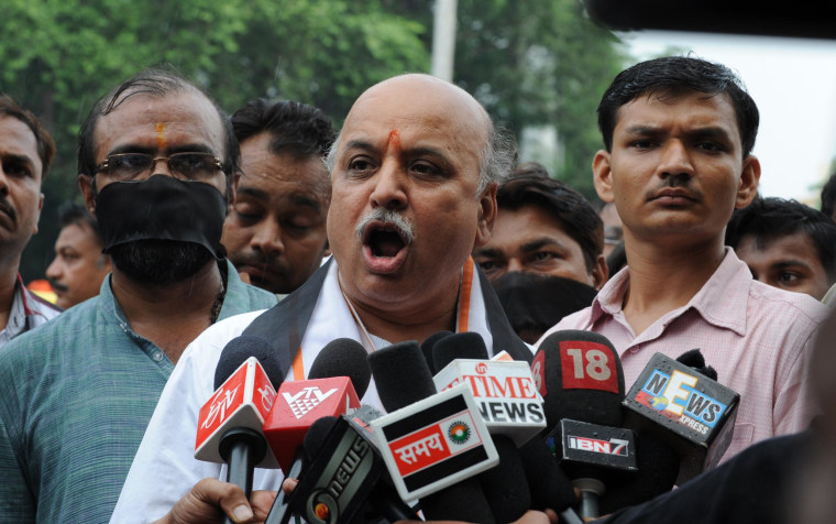 Vishwa Hindu Parishad (VHP) acting president, Pravin Togadia addresses media representatives ahead of a rally in Ahmedabad in September, 2012. Togadia and hundreds of VHP supporters participated in a the rally in support of those convicted in Naroda Patiya case in which some 97 Muslims were burnt alive in the 2002 Gujarat Riots.