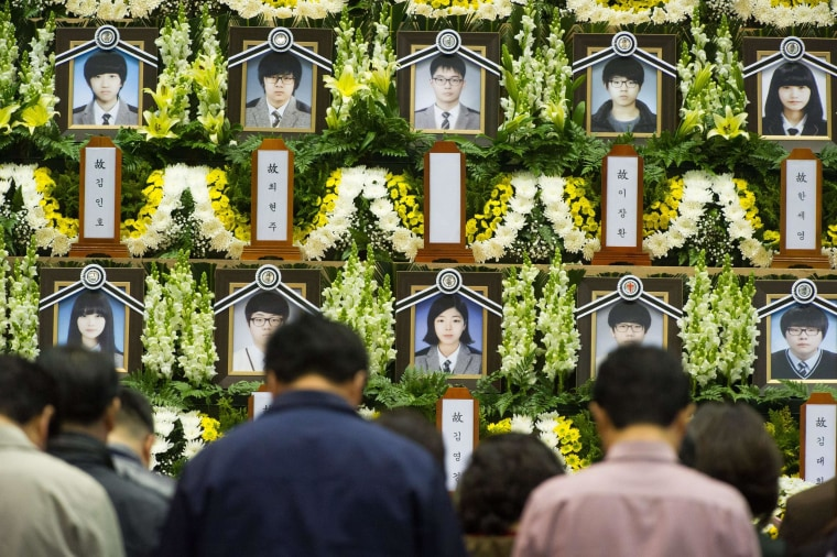 Image: People attend a memorial for the victims of the sunken South Korean ferry Sewol