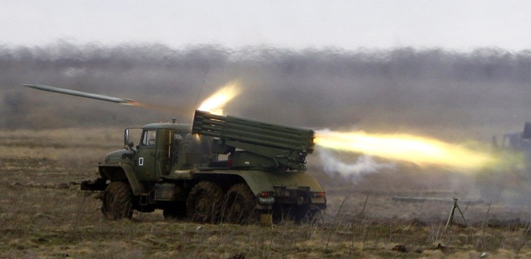 Image: A Russian BM-21 Grad multiple launch rocket system launches rockets during military exercises