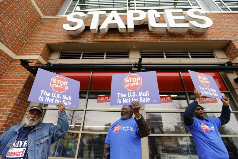 USPS workers picket outside Staples store