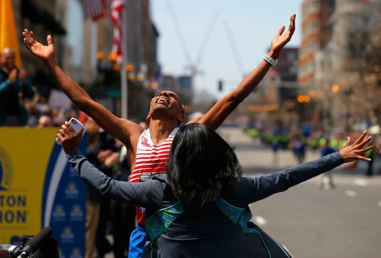 Image: Meb Keflezighi of the U.S. celebrates with his wife Yordanos Asgedom after winning the men's division at the 118th running of the Boston Marathon
