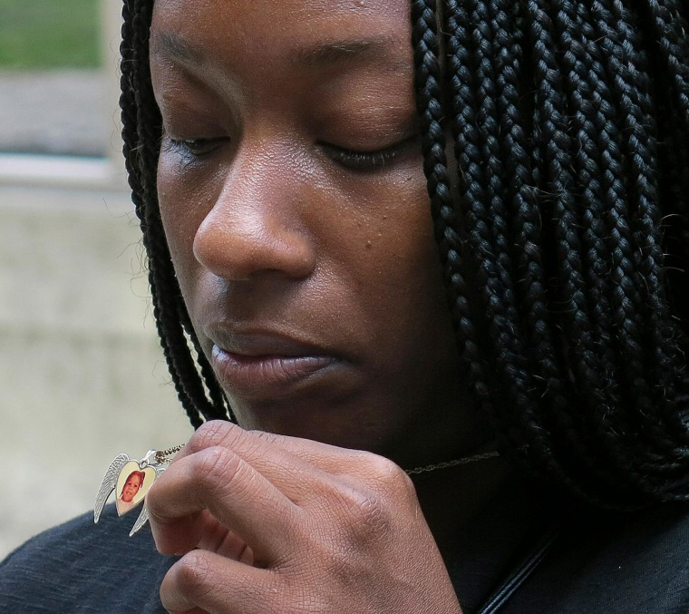 Image: Tarshia Williams displays a pendant with her daughter's face on it