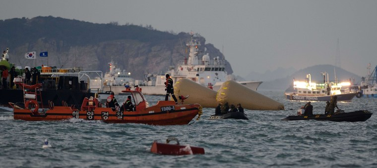 Coatguard boats and search and rescue teams take part in recovery operations at the site of the Sewol ferry off the coast of the South Korean island of Jindo on Thursday.