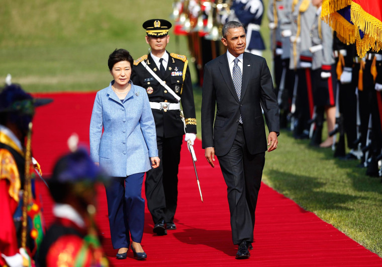 Image: President Obama and South Korean President Park inspect an honour guard at the presidential Blue House in Seoul