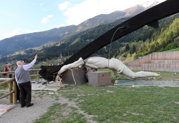 A giant crucifix dedicated to Pope John Paul II collapsed, killing a 21-year-old student, in Cevo, Italy, on April 24, 2014.
