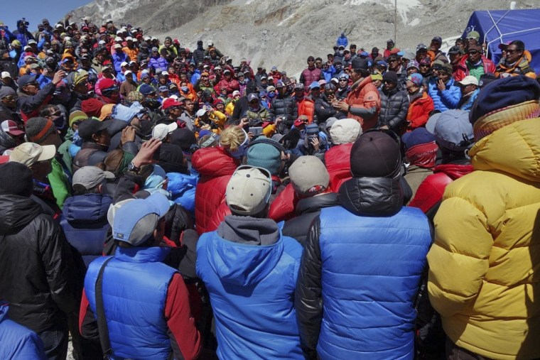 Image: A Nepalese government delegation and Sherpa mountain guides meet near Everest base camp