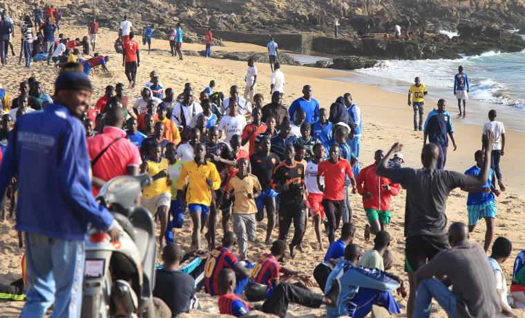 Men and boys work out on the beach in Dakar, Senegal.