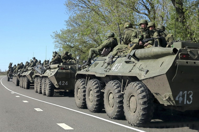 Russian servicemen drive armoured personnel carriers on the outskirts of the city of Belgorod near the Russian-Ukrainian border, April 25, 2014.