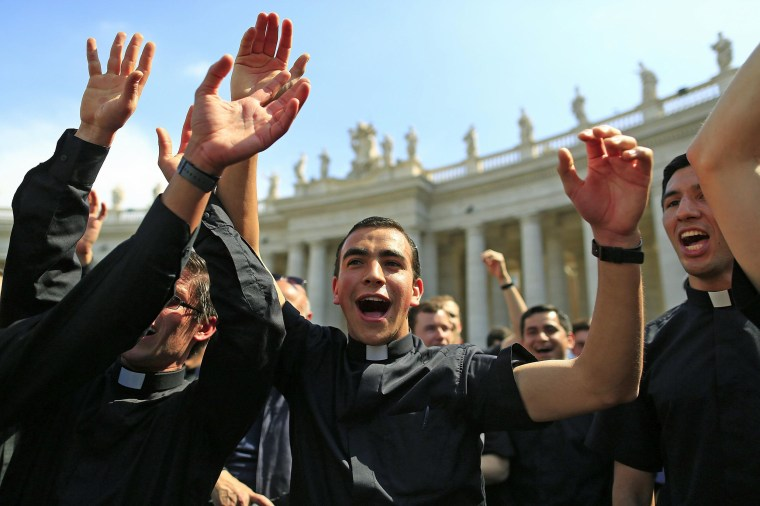 Priests sing and dance in Saint Peter's Square at the Vatican