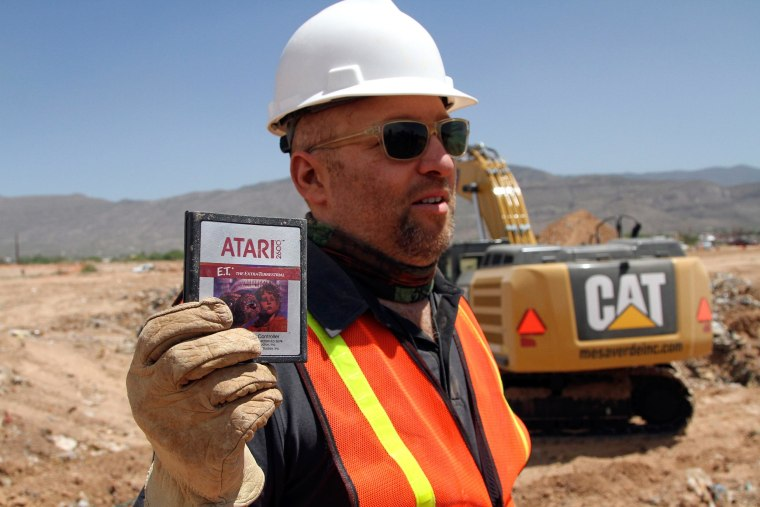 Image: Film Director Zak Penn shows a box of a decades-old Atari 'E.T. the Extra-Terrestrial' game found in a dumpsite in Alamogordo, N.M.