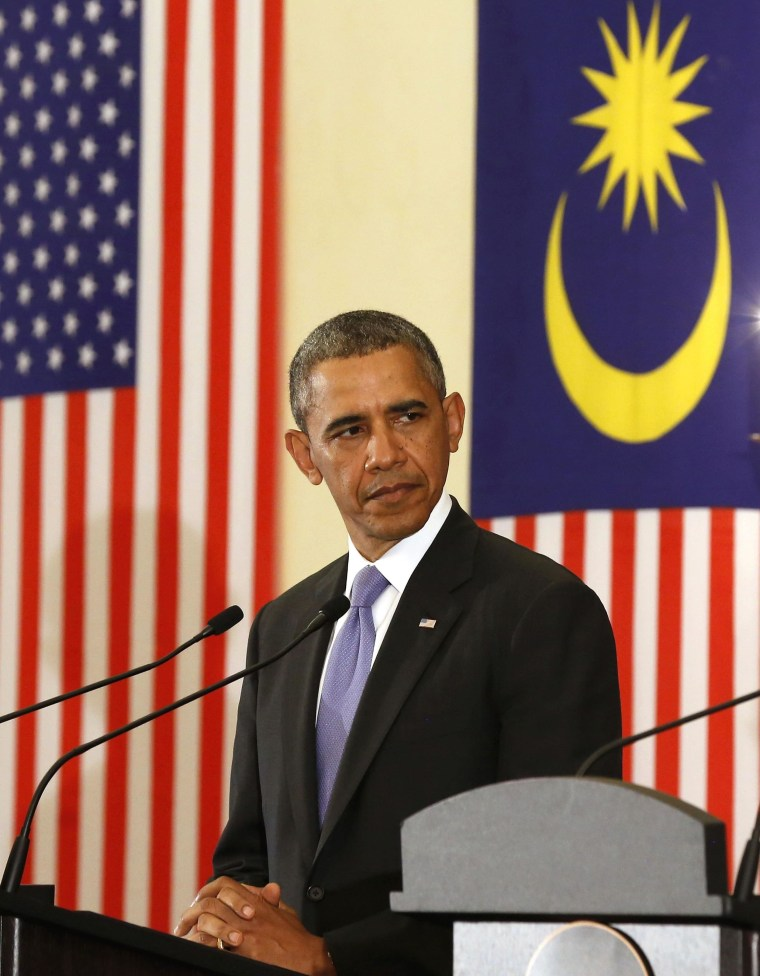 President Barack Obama listens to Malaysian Prime Minister Najib Razak speak in Putrajaya, Malaysia, on Sunday.