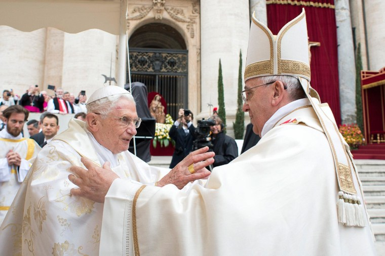 Image: Pope Francis embraces Pope Emeritus Benedict XVI during Mass before the canonisation ceremony of Popes John XXIII and John Paul II at St Peter's Square at the Vatican