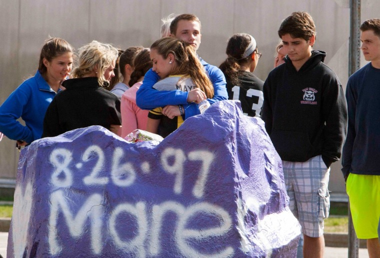 Image: Students mourn in front of Jonathan Law High School in Milford