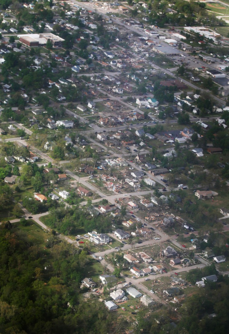 Image: A tornado's path is seen in an aerial photo made over Baxter Springs