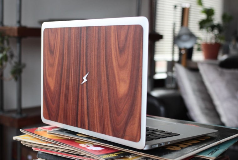 You can choose one of several symbols to be cut out and backlit on RawBKNY's laptop protector.