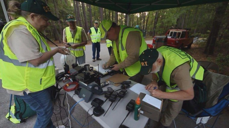 Searchers gather Monday morning at Congaree National Park in Hopkins, S.C.