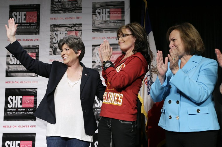 Iowa Republican Senatorial candidate Joni Ernst, left, former Alaska Gov. Sarah Palin, center, and U.S. Sen. Deb Fischer, R-Neb., right, wave to supporters during a campaign rally for Ernst, Sunday, April 27, 2014, in West Des Moines, Iowa.