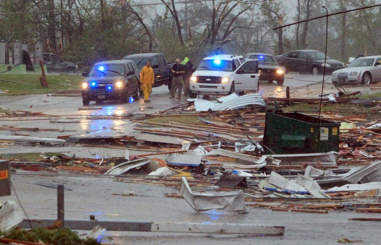 Image: First responders begin to secure areas minutes after a Tornado tore through Tupelo, Mississippi