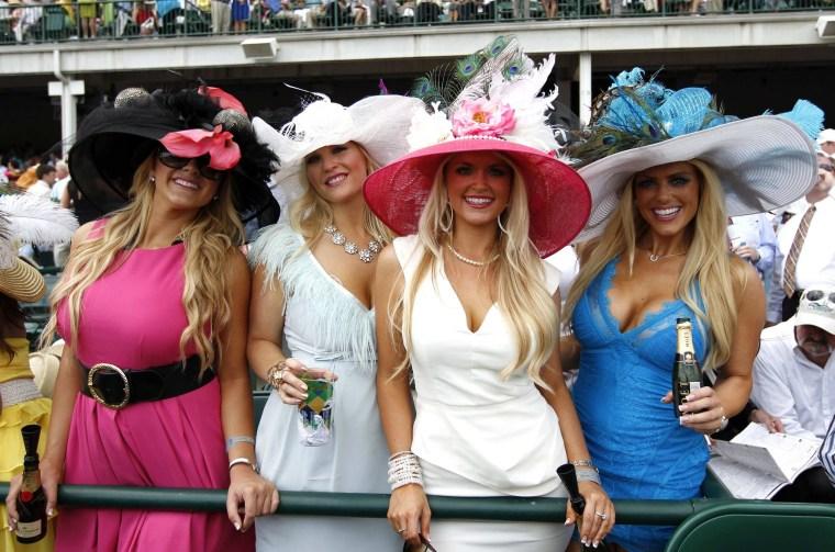 Image: Women wear fancy hats before the Kentucky Derby at Churchill Downs in Louisville
