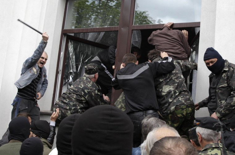 Image: Pro-Russian activists storm the regional government headquarters in Luhansk