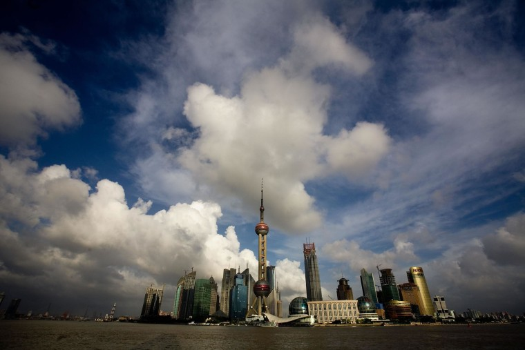 Clouds are seen over skyscrapers at the Lujiazui Financial District in Shanghai, China.
