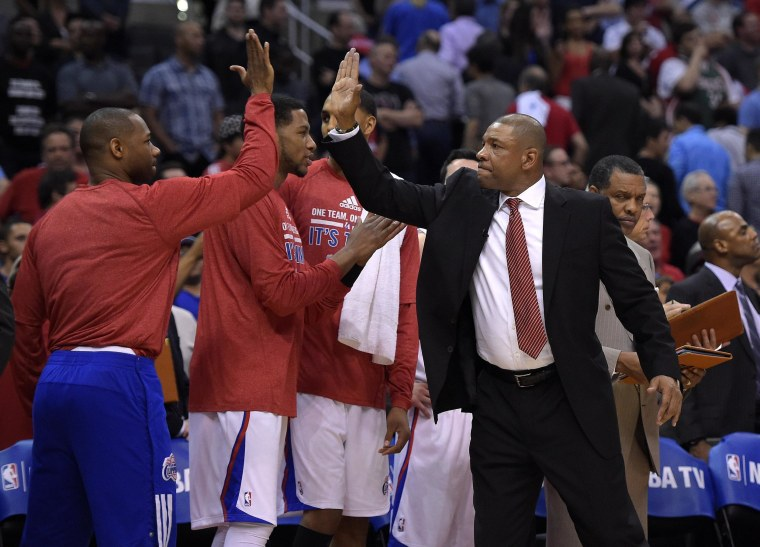 Los Angeles Clippers head coach Doc Rivers, right, congratulates members of his team during the second half in Game 5 of an opening-round NBA basketball playoff series against the Golden State Warriors, Tuesday, in Los Angeles. The Clippers won 113-103.