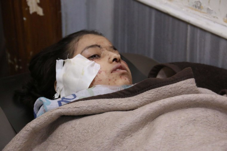 A young Syrian girl lays in a makeshift hospital bed after she was wounded in a reported air strike by government forces that hit the Ain Jalout school in the Ansari district of Aleppo, Syria, on April 30.