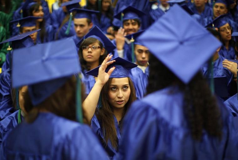 Image: Jazmine Raygoza adjusts her cap before her high school graduation in Denver