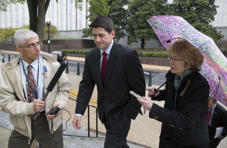Image: U.S. Representative Ryan talks to reporters as he departs a Republican House caucus meeting on Capitol Hill in Washington