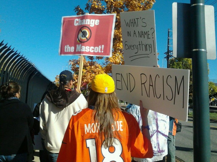 Image: Image: Protesting the Redskins name outside of Invesco Field in Denver