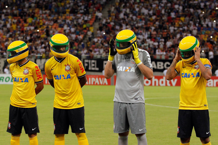Image: Players from Corinthians soccer club wear replicas of the helmet worn by late Formula One driver Ayrton Senna in Manaus