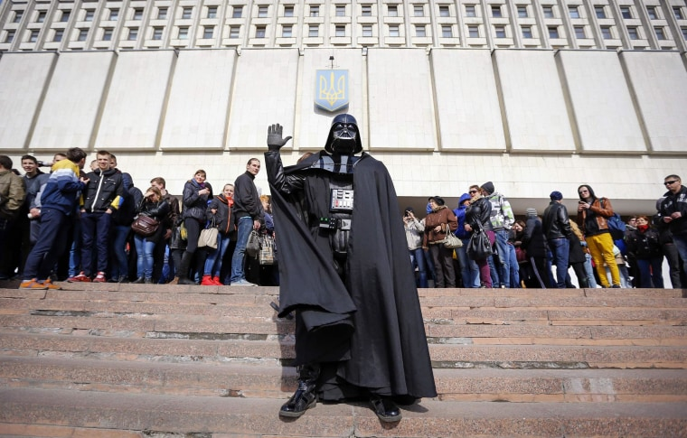 "Image: ""Darth Vader"", the leader of the Internet Party of Ukraine, stands during a rally in front of the Ukrainian Central Elections Commission in Kiev"