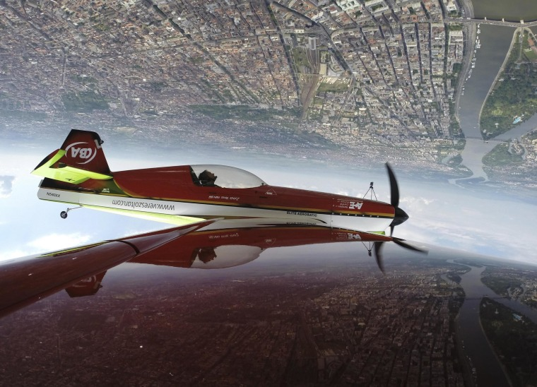 Image: Veres of Hungary performs with his MXS airplane during an air show in Budapest