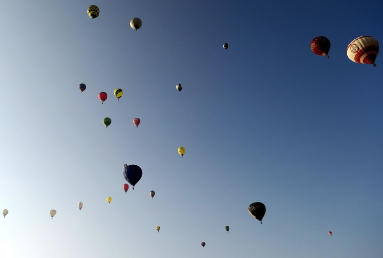 Image: Balloons at the start of the 15th International Mountain Balloon Race in Krosno, southern Poland