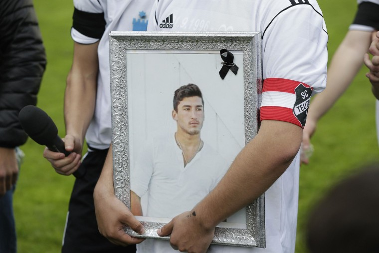 Image: Teammates, friends and relatives gather to remember Diren Dede at his football club
