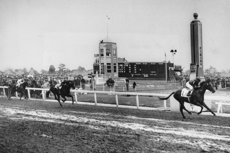 Image: Citation crosses the finish line three and one half lengths ahead of his stablemate, Coal Town to win the Kentucky Derby in 1948