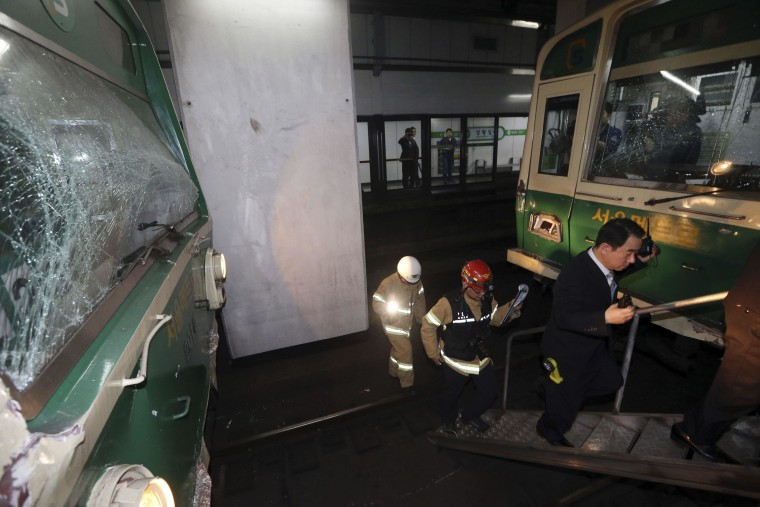 Image: Damaged subway trains are seen at a subway station in Seoul