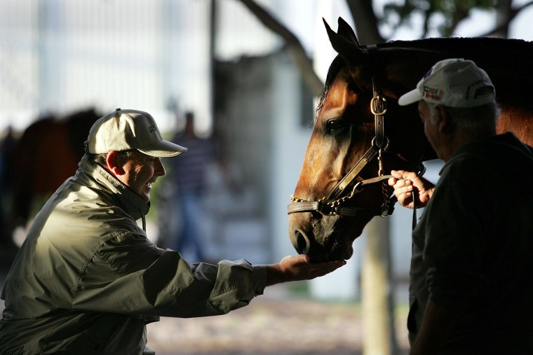 Image: Big Brown with his trainer Rick Dutrow  before he won the Kentucky Derby in 2008.