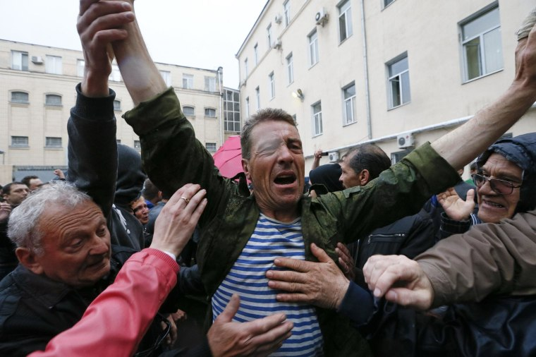 Image: Participants of a rally welcome a man who was just released from a city police department in Odessa