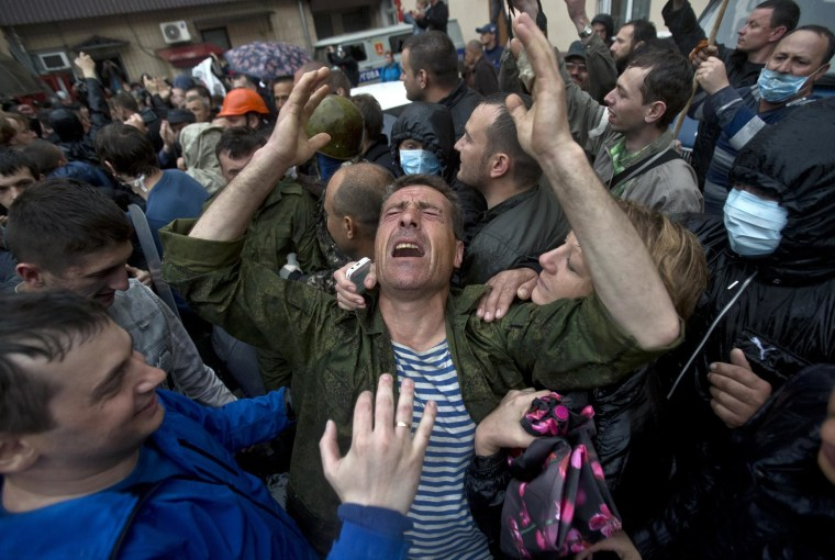 Image: A man cries after being released from a local police station which was stormed by pro-Russian protesters in Odessa