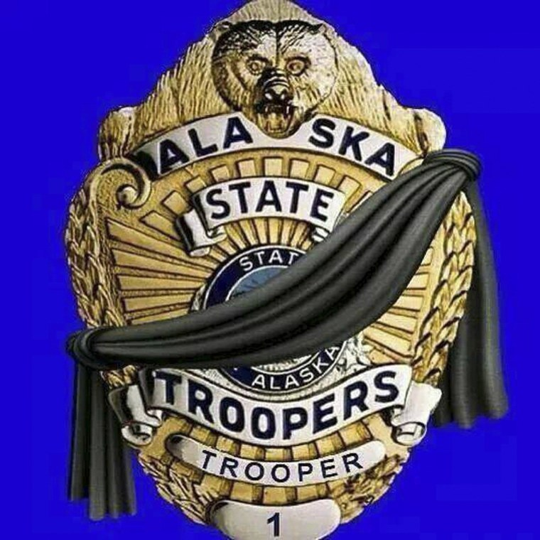 An illustration showing a black band across an officer's shield appears on the official Facebook page of the Alaska State Troopers in Anchorage May 2, 2014.