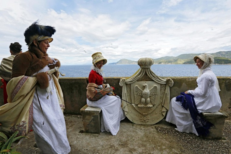 Image: People dressed in 19th century costumes re-enact the landing of French Emperor Napoleon Bonaparte
