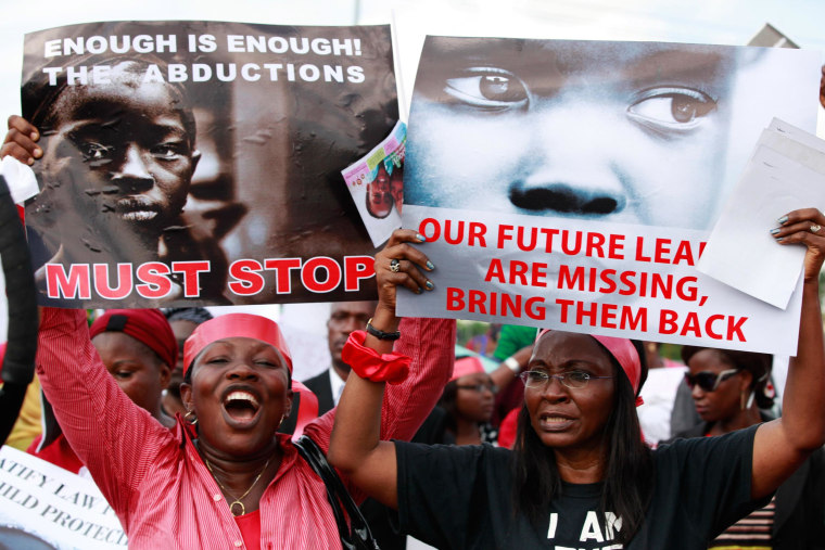 Image: Women attend a demonstration calling on government to rescue kidnapped school girls