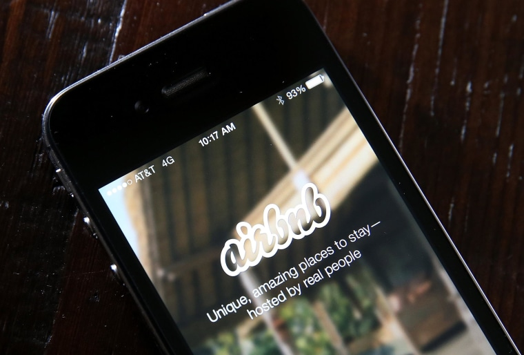 Image: The Airbnb app is displayed on a smartphone on April 21, 2014, in San Anselmo, California.