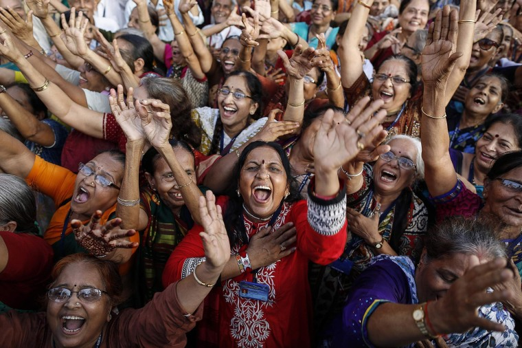 Image: Members of a laughter club participate in a laughing exercise in Mumbai