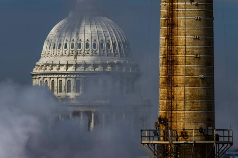 Image: The dome of the U.S. Capitol is seen behind the emissions, and a smokestack, from the Capitol Power Plant, the only coal-burning power plant in the nation's capitol