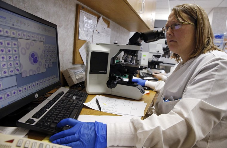 Image: Shay Wilinski works in the Microbiology Lab at Community Hospital, where a patient with the first confirmed U.S. case of Middle East Respiratory Syndrome is in isolation, in Munster, Indiana