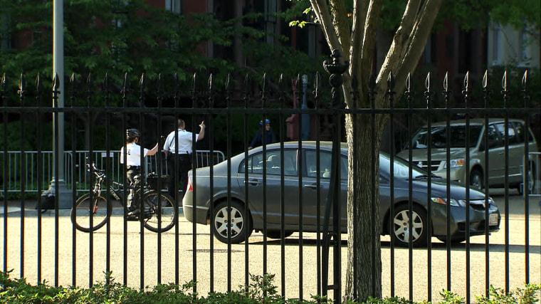 Image: A suspicious vehicle trailed a motorcade carrying Malia and Sasha Obama onto the White House grounds