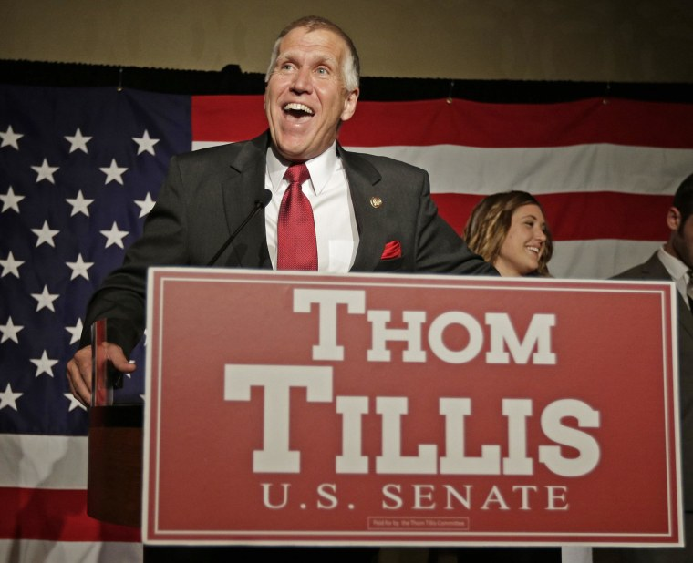 Image: Thom Tillis speaks to supporters at a election night rally in Charlotte