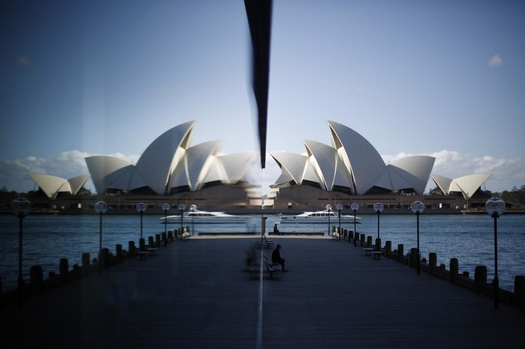 Image: The Sydney Opera House is reflected in a harbourside hotel window in The Rocks district of Sydney